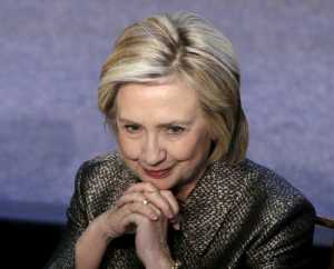 U.S. former Secretary of State, and now a Democratic presidential candidate, Hillary Rodham Clinton, attends a Georgetown University luncheon to deliver remarks and present awards for the Advancement of Women in Peace and Security in Washington April 22, 2015.       REUTERS/Gary Cameron  - RTX19UME