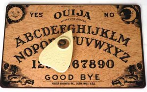 Mandatory Credit: Photo by Jon Santa Cruz / Rex Features (582062k) Ouija board with pointer VARIOUS - 2006